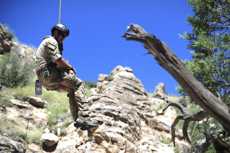 A pararescueman from the 48th Rescue Squadron descends into a ravine from a highline at the Coronado National Forest in Tucson, Ariz., Sept. 16, 2016. The 48th RQS provides highly trained experts capable of executing personnel recovery operations across the spectrum of conflict. (U.S. Air Force photo by Airman Nathan H. Barbour)