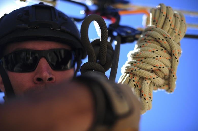 A pararescueman from the 48th Rescue Squadron traverses a ravine on a highline at the Coronado National Forest in Tucson, Ariz., Sept. 16, 2016. Airmen from the 48th RQS completed a week of high angle rescue training where they were taught to use ropes to extract someone who may be trapped at the bottom of a ravine. (U.S. Air Force photo by Airman Nathan H. Barbour)