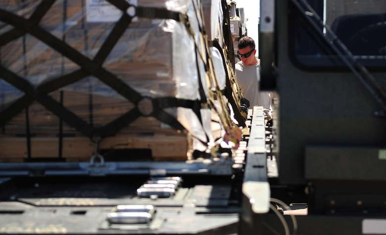 U.S. Air Force Staff Sgt. Eric Hazelwood, 7th Logistics Readiness Squadron air transportation craftsman, prepares to load pallets at Dyess Air Force Base, Texas, Sept. 20, 2016. This cargo was donated from Global Samaritan Resources based in Abilene, Texas, and the food will be transported to an air base near Erbil, Iraq, for distribution to Iraqi refugees. (U.S. Air Force photo by Airman 1st Class April Lancto)