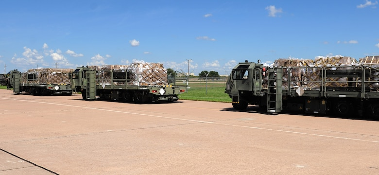 U.S. Air Force K Loaders standby in preparation for loading Global Samaritan Resources' pallets of food as part of a humanitarian assistance mission at Dyess Air Force Base, Texas, Sept. 20, 2016. The shipment contained approximately 475,000 servings of fortified dehydrated food that will be used to help feed Iraqi refugees. (U.S. Air Force photo by Airman 1st Class April Lancto)