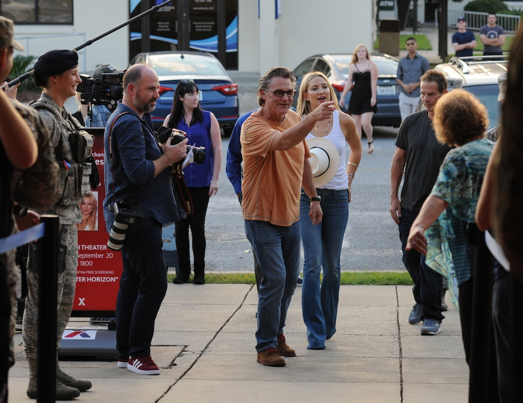 Kurt Russell and Kate Hudson, Deepwater Horizon actors, arrive at the Welch Theater before the Deepwater Horizon movie screening Sept. 20, 2016, on Keesler Air Force Base, Miss. Before the screening, Russell, Hudson and movie director, Peter Berg, took a short tour of the 81st Training Wing and 403rd Wing to meet with Airmen and learn about their missions at Keesler. (U.S. Air Force photo by Kemberly Groue/Released)
