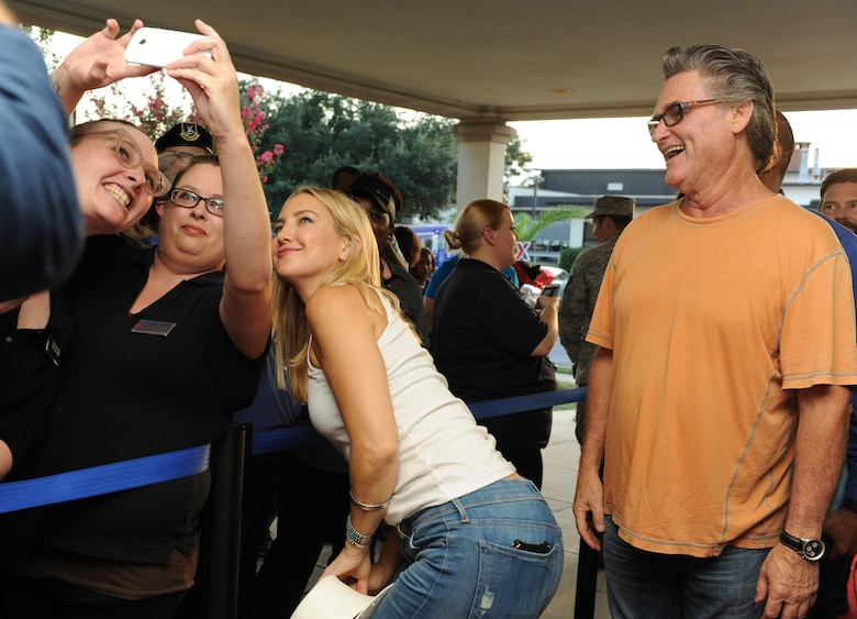 Kate Hudson, Deepwater Horizon actress, takes a photo with Keesler personnel at the Welch Theater before the Deepwater Horizon movie screening Sept. 20, 2016, on Keesler Air Force Base, Miss. Before the screening, actor Kurt Russell, Hudson and Peter Berg, Deepwater Horizon director, took a short tour of the 81st Training Wing and 403rd Wing to meet with Airmen and learn about their missions at Keesler. (U.S. Air Force photo by Kemberly Groue/Released)