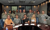 Peter Berg, Deepwater Horizon director, Kurt Russell and Kate Hudson, Deepwater Horizon actors, pose for a photo with 81st Training Wing leadership at the 81st TRW Headquarters Building before the Deepwater Horizon movie screening Sept. 20, 2016, on Keesler Air Force Base, Miss. Before the screening, Russell, Hudson and Berg took a short tour of the 81st TRW and 403rd Wing to meet with Airmen and learn about their missions at Keesler. (U.S. Air Force photo by Kemberly Groue/Released)