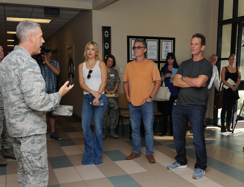 Kate Hudson, Kurt Russel, Deepwater Horizon actors, and Peter Berg, Deepwater Horizon director, receive a briefing from Lt. Col. Steven Mullins, 334th Training Squadron commander, at Cody Hall before the Deepwater Horizon movie screening Sept. 20, 2016, on Keesler Air Force Base, Miss. Before the screening, Russell, Hudson and Berg took a short tour of the 81st Training Wing and 403rd Wing to meet with Airmen and learn about their missions at Keesler. (U.S. Air Force photo by Kemberly Groue/Released)