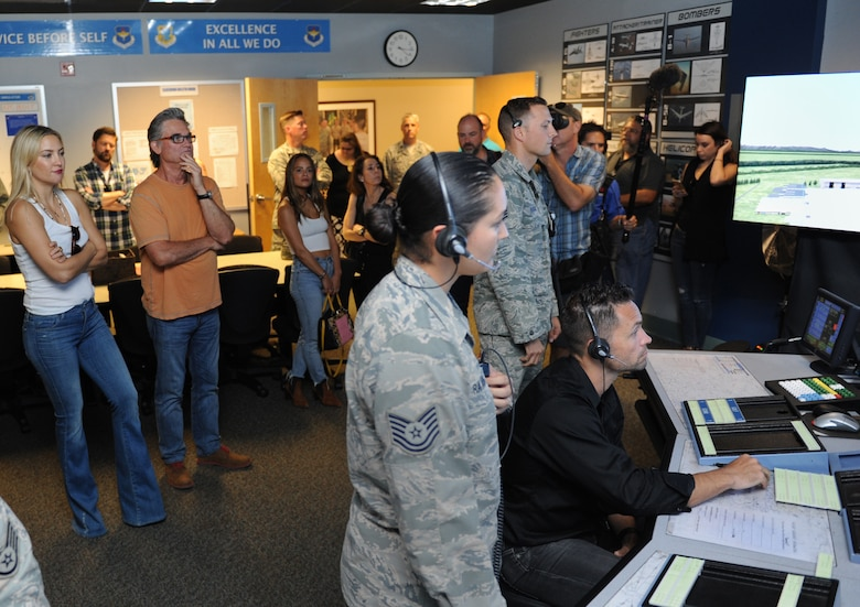 Kate Hudson and Kurt Russel, Deepwater Horizon actors, receive a tour of the 334th Training Squadron air traffic control tower simulator at Cody Hall before the Deepwater Horizon movie screening Sept. 20, 2016, on Keesler Air Force Base, Miss. Before the screening, Russell, Hudson and movie director, Peter Berg, took a short tour of the 81st Training Wing and 403rd Wing to meet with Airmen and learn about their missions at Keesler. (U.S. Air Force photo by Kemberly Groue/Released)