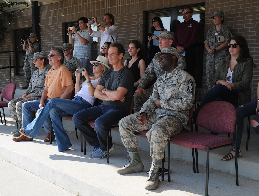 Kurt Russell, Kate Hudson, Deepwater Horizon actors, and Peter Berg, Deepwater Horizon director, watch a 336th Training Squadron drill down demonstration at the Levitow Training Support Facility drill pad before the Deepwater Horizon movie screening Sept. 20, 2016, on Keesler Air Force Base, Miss. Before the screening, Russell, Hudson and Berg, took a short tour of the 81st Training Wing and 403rd Wing to meet with Airmen and learn about their missions at Keesler. (U.S. Air Force photo by Kemberly Groue/Released)