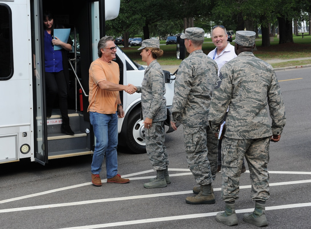 Kurt Russell, Deepwater Horizon actor, is greeted by Col. Michele Edmondson, 81st Training Wing commander, at the 81st TRW Headquarters Building before the Deepwater Horizon movie screening Sept. 20, 2016, on Keesler Air Force Base, Miss. Before the screening, Russell, actress, Kate Hudson, and movie director, Peter Berg, took a short tour of the 81st TRW and 403rd Wing to meet with Airmen and learn about their missions at Keesler. (U.S. Air Force photo by Kemberly Groue/Released)
