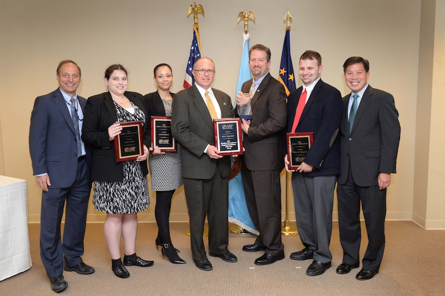 Left to right: Peter K. Levine, acting undersecretary of defense for personnel and readiness; award recipients Emily Lipkin, Kerri Smith, Eric Spanbauer, Brad Bunn and Robert Tanner; and Deputy Labor Secretary Christopher P. Lu pose for a photo during the 2016 Workforce Recruitment Program Award ceremony.
