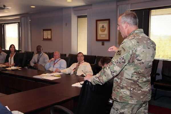 Col. John Hurley, commander, U.S. Army Engineering and Support Center, Huntsville, talks to members of Huntsville Center's Housing Planning Response Team Sept. 15, 2016, as they prepare to travel to Baton Rouge, Louisiana, to support the flood recovery effort.