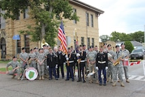 1st Infantry Division Marching Band with the local veteran's color guard after the Post Rock Festival Parade in Lincoln, Kansas on Sept. 3, 2016.