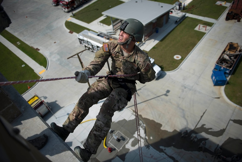 Airmen from the Oklahoma Air National Guard's 138th and 137th Security Forces Squadrons perform rappelled descent maneuvers at the Tulsa Fire Safety Training Center, Tulsa, Okla., Sept. 15, 2016. The training was conducted to meet annual recertification and provide their respective bases with the means to meet domestic operation mission requirements. (U.S. Air National Guard photo/Tech. Sgt. Drew A. Egnoske)