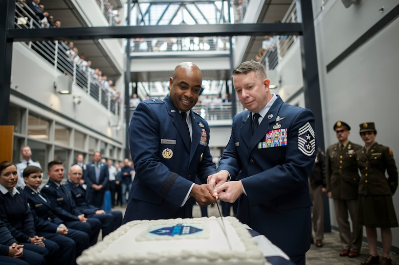 Brig. Gen. Trent Edwards, the Air Force Space Command director of financial management and comptroller and Chief Master Sgt. Brendan Criswell, the AFSPC command chief, use the ceremonial sword to cut the Air Force birthday cake, Sept. 16, 2016, at Peterson Air Force Base, Colo. More than 125 members from AFSPC attended the Air Force Birthday ceremony. (U.S. Air Force photo/Tech. Sgt. David Salanitri)