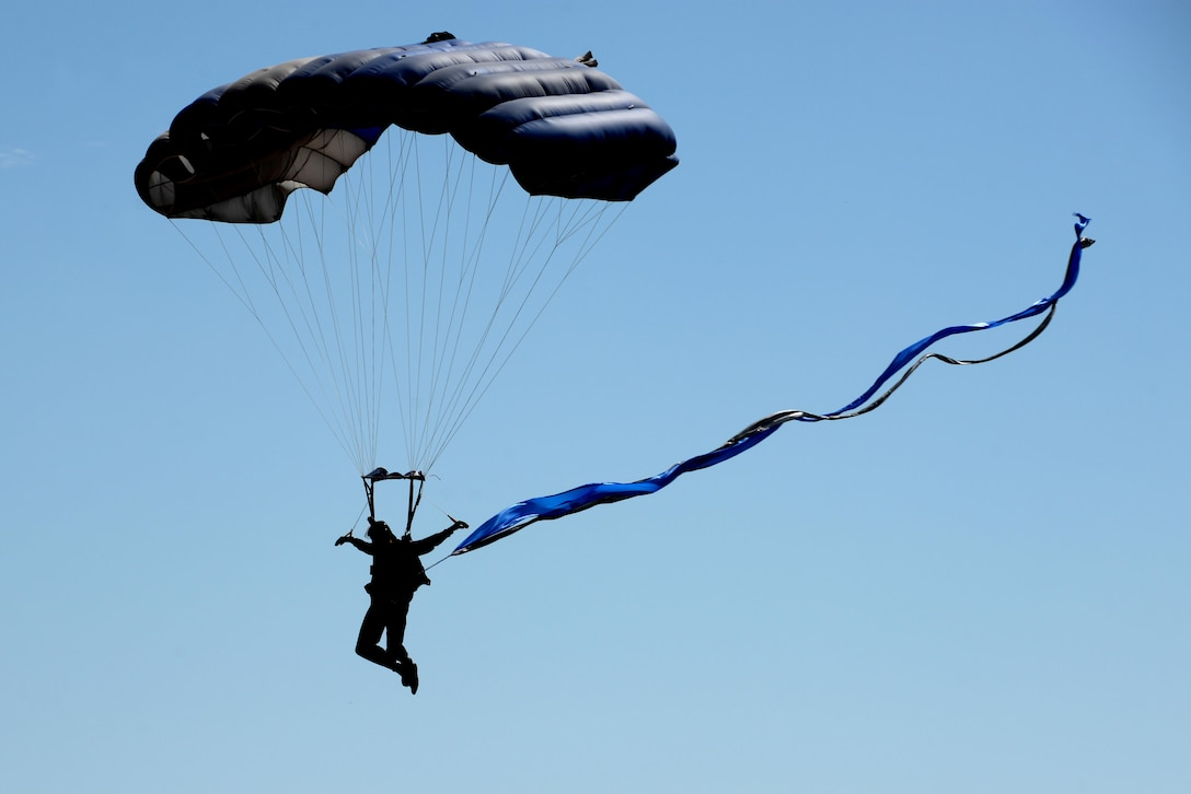 A member of the U.S. Air Force Wings of Blue parachute team descends toward Sheppard Air Force Base, Texas, during the 75th Anniversary Air Show Celebration, Sept. 17, 2016. Wings of Blue opened the air show with a demonstration by Dana Bowman, a skydiver and retired U.S. Army sergeant first class. (U.S. Air Force photo/Senior Airman Kyle E. Gese)