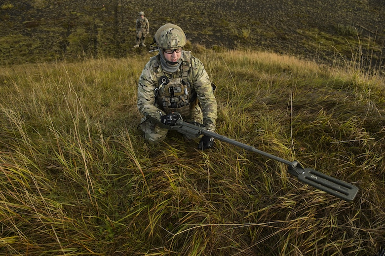 Tech. Sgt. Jason Umlauf, a 52nd Civil Engineer Squadron explosive ordnance disposal craftsman, sweeps an area with a mine detector during exercise Northern Challenge 16 in Keflavik, Iceland, Sept. 19, 2016. The exercise focused on disabling improvised explosive devices in support of counterterrorism tactics to prepare Partnership for Peace, NATO, and Nordic nations for international deployments and defense against terrorism. (U.S. Air Force photo/Staff Sgt. Jonathan Snyder)