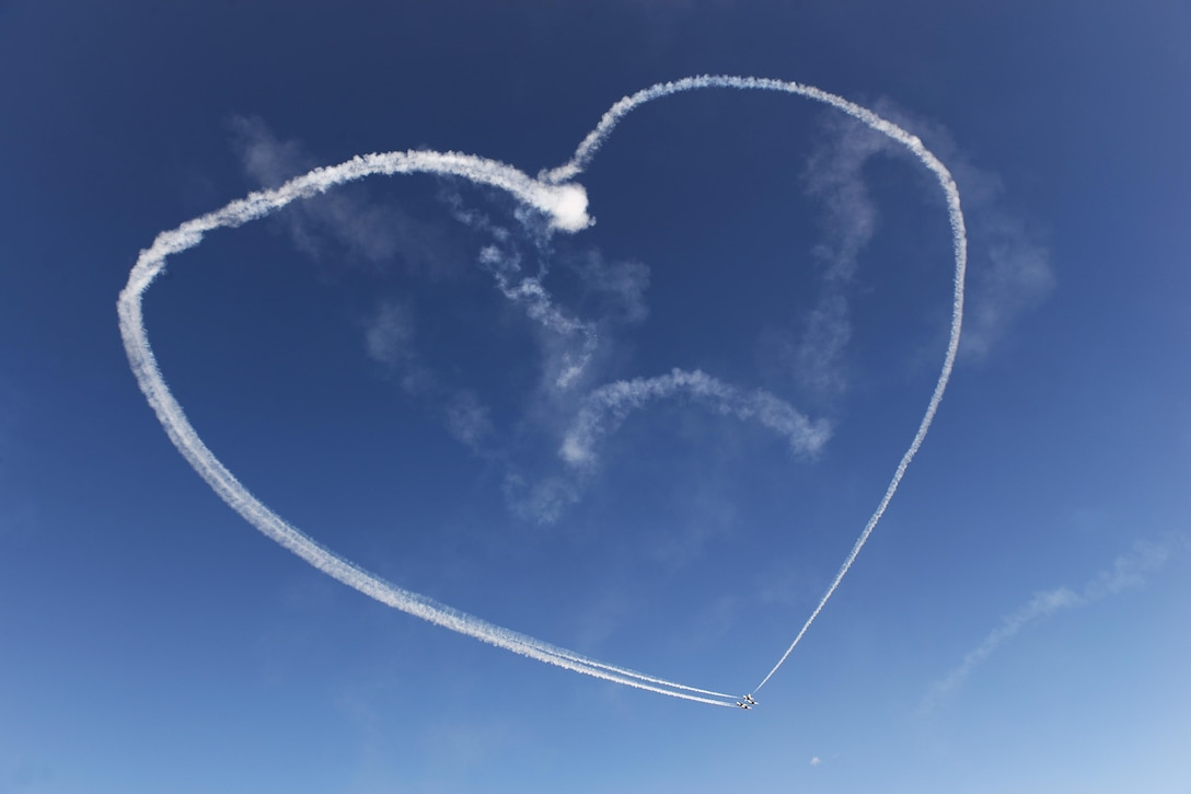 The U.S. Air Force Thunderbirds form a heart for deployed Airmen and their families during the 75th Anniversary Air Show Celebration at Sheppard Air Force Base, Texas, Sept. 17, 2016. Since 1953, the Thunderbirds have performed for millions, spreading the word about the Air Force and its precision, skill and decisive combat power. (U.S. Air Force photo/Senior Airman Kyle E. Gese)