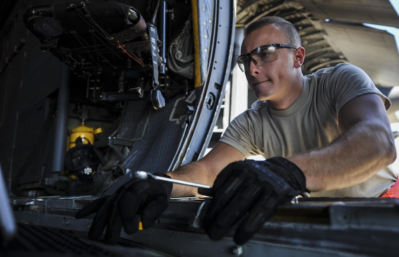 Airman 1st Class Nicolas Stamper, a crew chief with the 15th Aircraft Maintenance Unit, references a technical guide from a laptop at Hurlburt Field, Fla., Sept. 21, 2016. Crew chiefs with the 15th AMU are trained to diagnose malfunctions on the MC-130H Combat Talon II during pre-flight and post-flight inspections, repair and refuel the aircraft, keep detailed records, marshal aircraft and ensure the aircraft are mission ready at all times. (U.S. Air Force photo by Airman 1st Class Joseph Pick)
