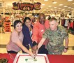 1st Infantry Division and Fort Riley Community leaders cut the cake after Fort Riley's Armed Forces Bank received the Department of the Army's Bank of the Year award. Pictured from left to right are: Leisa Foster, Fort Riley/Junction City Banking Center Manager, Monique Amritt-Cothern, Fort Riley General Exchange Banking Center Manager, Bill Brooks, Fort Riley General Banking Center Manager and Brig. Gen. Patrick Frank, Deputy Commanding General, 1st Infantry Division.
