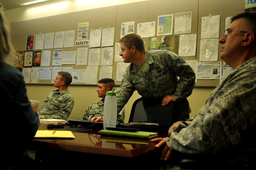 Tech. Sgt. John McIntosh, Buckley Air Force Base Chapel operations NCO in charge, takes lead of the chapel's Operational Security briefing September 15, 2016, at Buckley AFB, Colo. Chaplains and chaplain assistants are still held to the same standards; this includes the completion of annual and quarterly briefings. (U.S. Air Force photo by Airman Holden S. Faul/ Released)