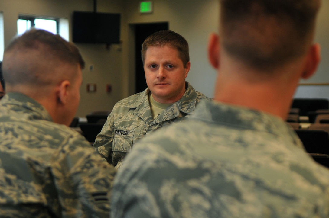 Tech. Sgt. John McIntosh, Buckley Air Force Base Chapel operations NCO in charge, sits with new Airmen during lunch September 15, 2016, at Buckley AFB, Colo. The role of a chaplain assistant is to provide ministry support through direct unit involvement and administrative and logistical support. (U.S. Air Force photo by Airman Holden S. Faul/ Released)