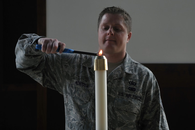 Tech Sgt. John P. McIntosh, 460th Space Wing chapel operations NCO in charge, lights a candle during a training to prepare for a chapel service September 15, 2016, at Buckley AFB, Colo. Although it's not their normal duty to prepare the chapel for services, chaplain assistants are called upon to do so when deployed. (U.S. Air Force photo by Airman Holden S. Faul)