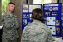 Tech. Sgt. Nicholas Hunt, 140th  Wing Colorado Air National Guard chapel operations NCO in charge, informs an Airman on the services the Buckley Air Force Base Chapel provides on September 21, 2016 at Buckley AFB, Colo. The chapel offers year-round activities and trips for both single and married Airmen. (U.S. Air Force photo by Airman Holden S. Faul/ Released)