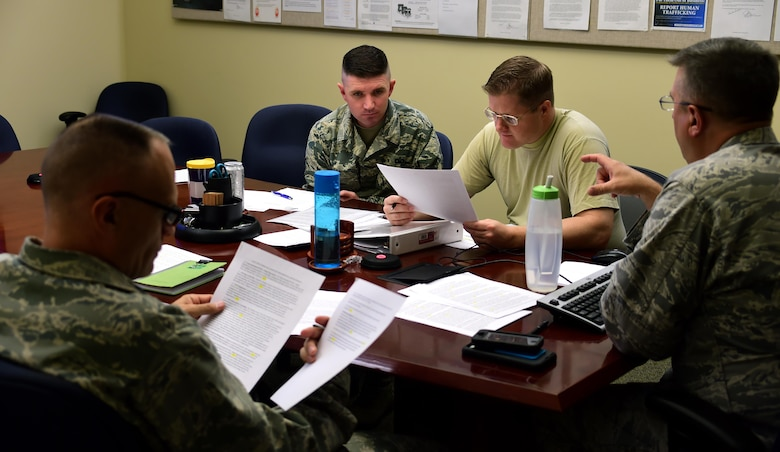Tech. Sgt. Nicholas Hunt, 140th  Wing Colorado Air National Guard chapel operations NCO in charge and Tech. Sgt. John McIntosh, Buckley Air Force Base Chapel operations NCO in charge, sit in a meeting with two of Buckley AFB's chaplains September 21, 2016, at Buckley AFB, Colo. A chaplain and chaplain assistant form a Religious Support Team and are assigned to actively engage each squadron and provide warrior care that is supportive to all Airmen. (U.S. Air Force photo by Airman Holden S. Faul/ Released)