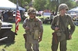 Retired Sgt. 1st Class Brendon Cordero stands next to Sgt. Christopher Smith, 1st Combined Arms Battalion, 63rd Armor Regiment, 2nd Armored Brigade Combat Team, 1st Infantry Division, reenacted the roles of World War II soldiers at Fall Apple Day Festival Sept. 10. The unit is from the World War II museum in El Dorado, Kansas.