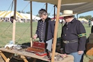 Dr. Joe Schlageck, left, of Kansas City, Missouri, and Paul Anderson, right, stand in front of a display of surgical instruments used during the Civil War, at the Fall Apple Day Festival Sept. 10. The display is an exhibit done by the 8th Kansas, Frontier Brigade, Frontier Battalion out of Kansas City, Missouri.