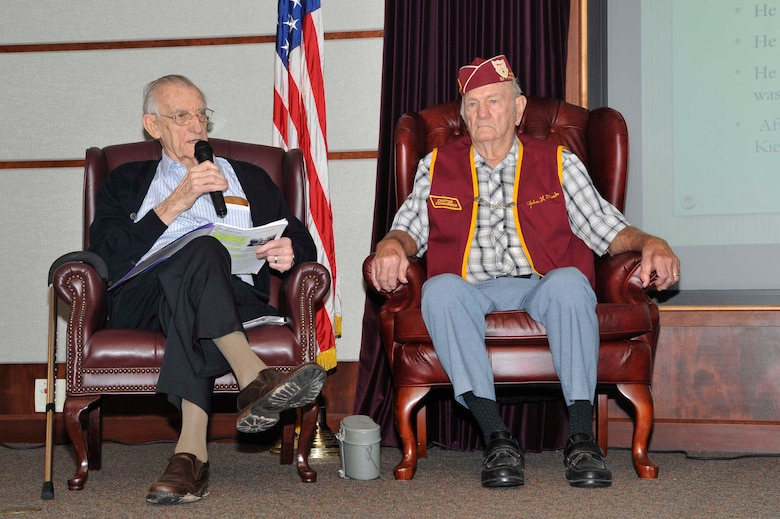 Walter Lawrence, left, and John Mock, World War II POWs, share their stories at a speaking event, Sept. 14, 2016, at McConnell Air Force Base, Kan. The men shared their stories of internment with McConnell's Airmen during this year's POW/MIA week. (U.S. Air Force photo/Airman Erin McClellan)