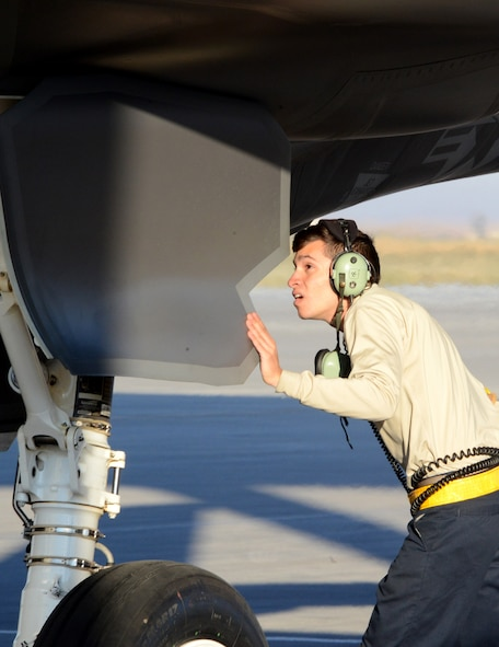Airman 1st Class Dennis Hesse, 61st Aircraft Maintenance Unit crew chief, inspects the wheel well and assembly September 16, 2016, prior to launching an F-35 Lightning II at Mountain Home Air Force Base, Idaho. Luke sent jets to Mountain Home AFB because it provides a unique opportunity for developing proficiency in the destruction of surface-to-air threats at their range complex. (U.S. Air Force photo by Tech. Sgt. Timothy Boyer)