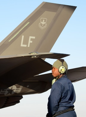Senior Airman Teddy Colbert, 61st Aircraft Maintenance Unit F-35 crew chief, waits for the pilot to perform engine checks September 16, 2016, prior to launching an F-35 Lightning II at Mountain Home Air Force Base, Idaho. Luke sent jets to Mountain Home AFB because it provides a unique opportunity for developing proficiency in the destruction of surface-to-air threats at their range complex. (U.S. Air Force photo by Tech. Sgt. Timothy Boyer)