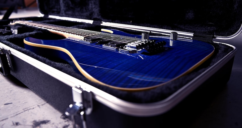 Airman 1st Class Zacary Heinzerling, 460th Security Forces Squadron apprentice, displays his 2009 transparent blue Ibanez guitar September 8, 2016, at Buckley Air Force Base, Colo. This guitar is one of nine owned by Heinzerling, who has been playing music since he was 10 years old. (U.S. Air Force photo by Airman Holden S. Faul/ Released)