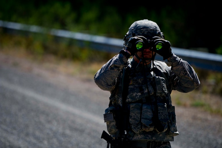 A Citizen Airman from the 446th Security Forces Squadron scans the area as part of a large-scale Field Training Exercise at Joint Base Lewis-McChord September 8 - 11th. The exercise focused on training Citizen Airmen on expeditionary tactics and procedures. (U.S. Air Force Reserve photo by Staff Sgt. Daniel Liddicoet)