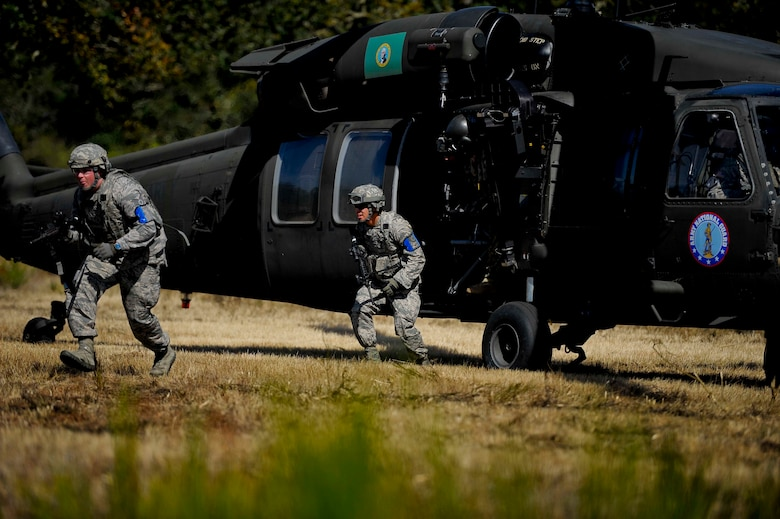Two members from the 446th Security Forces Squadron arrive for the expeditionary exercise from a U.S. Army UH-60 Black Hawk helicopter. The expeditionary exercise kicked off over the September Unit Training Assembly and concluded Sept. 11. (U.S. Air Force Reserve photo by Staff Sgt. Daniel Liddicoet)