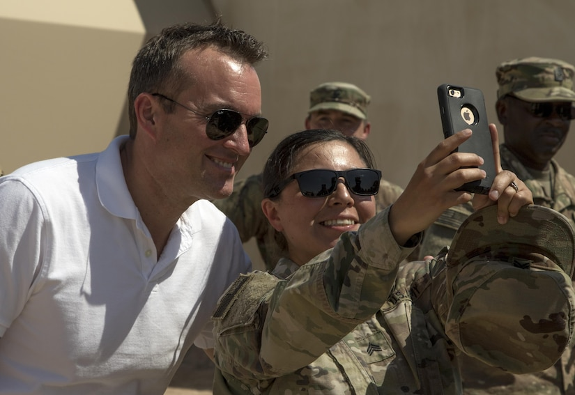 U.S. Army Secretary Eric Fanning, left, takes a selfie with Sgt. Nancy Herrera, a signal support systems specialist with the 863rd Engineer Battalion, 176th Engineer Brigade, during a tour Sept. 19 at Camp Buehring, Kuwait. The Army's top civilian met with U.S. Army Central units at Camp Buehring and Camp Arifjan as part of a larger tour that also included meeting Soldiers in Afghanistan and Iraq. (U.S. Army photo by Sgt. Brandon Hubbard)