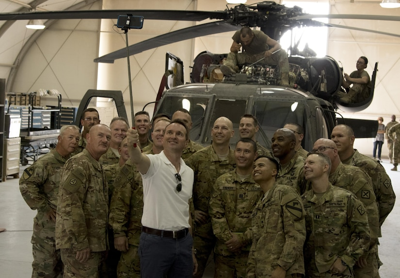 U.S. Army Secretary Eric Fanning, center, takes a selfie with Soldiers from U.S. Army Central and the 77th Combat Aviation Brigade in a hangar Sept. 19 at Camp Buehring, Kuwait. The Army's top civilian met with U.S. Army Central units at Camp Buehring and Camp Arifjan as part of a larger tour that also included meeting Soldiers in Afghanistan and Iraq. (U.S. Army photo by Sgt. Brandon Hubbard)