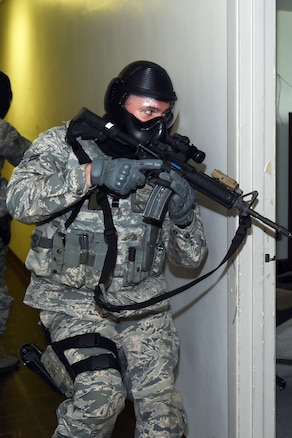 160917-Z-EZ686-008 -- A member of the 127th Security Forces Squadron participates in an active shooter training scenario in the halls and rooms of a vacant office building at Selfridge Air National Guard Base, Mich., on Sept. 17, 2016.  The training goal is to teach Airmen to shoot, move and communicate and for each SF member to become proficient at applying these skills.  (U.S. Air National Guard photo by MSgt. David Kujawa/Released)