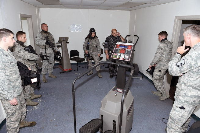 160917-Z-EZ686-005 -- Members of the 127th Security Forces Squadron come together to discuss training techniques implemented during an active shooter training scenario in the halls and rooms of a vacant office building at Selfridge Air National Guard Base, Mich., on Sept. 17, 2016.  The training goal is to teach Airmen to shoot, move and communicate and for each SF member to become proficient at applying these skills.  (U.S. Air National Guard photo by MSgt. David Kujawa/Released)