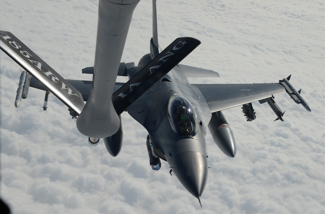 A U.S. Air Force KC-135, from the 185th Air Refueling Wing, Iowa Air National Guard, is refueling a U.S. Air Force F-16 from the South Dakota Air National Guard's 114th Fighter Wing, based in Sioux Falls, SD while above Lake Andes, South Dakota, on September 22, 2016.  U.S. Air National Guard photo by Master Sgt. Vincent De Groot 185th ARW Wing PA