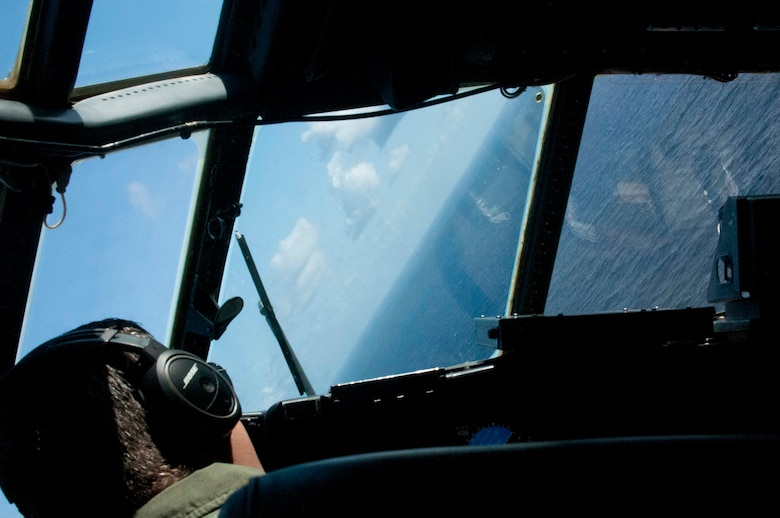 A U.S. Air Force pilot from the Georgia Air National Guard's 165th Airlift Wing executes evasive maneuvers while being escorted by fighters during Sentry Aloha at Joint Base Pearl Harbor-Hickam, Hawaii on Aug. 29 2016. This iteration of Sentry Aloha involved over 800 personnel and over 40 aircraft from eight other states and territories. (U.S. Air National Guard photo by Airman 1st Class Stan Pak/released)