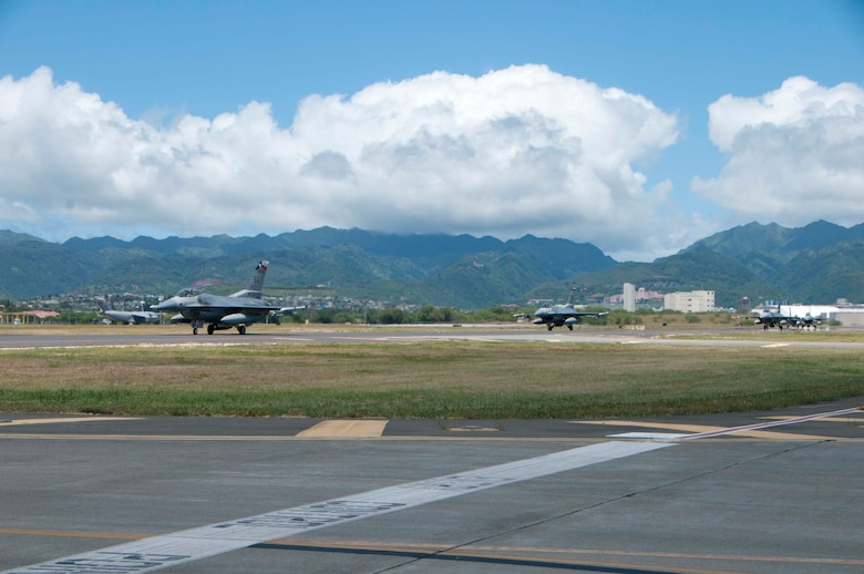 U.S. Air Force F-16 Fighting Falcons from the Texas Air National Guard 149th Fighter Wing, taxis on Joint Base Pearl Harbor-Hickam, Hawaii on Aug. 17, 2016. The visiting airmen and aircraft are participating in the Hawaii Air National Guard's Sentry Aloha exercise. This Sentry Aloha iteration will involve more than 800 personnel and more than 40 aircraft from eight other states and territories.(U.S. Air National Guard photo by Airman 1st Class Stan Pak/released)