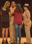Chief Petty Officer Terry McCray-Matt, a newly Promoted Chief, gets pinned by her daughter Cyrah McCray-Matt and her mother Terry McCray at the base theater at Marine Corps Base Camp Lejeune, Sept. 16. The ceremony happened at the end of a six weeks transition period for Petty Officers 1st Class in to Chief Petty Officers where they are given first-hand knowledge on what it means to be a Chief in the Navy. (U.S. Marine Corps photo by Lance Cpl. Tavairus Hernandez /Released)