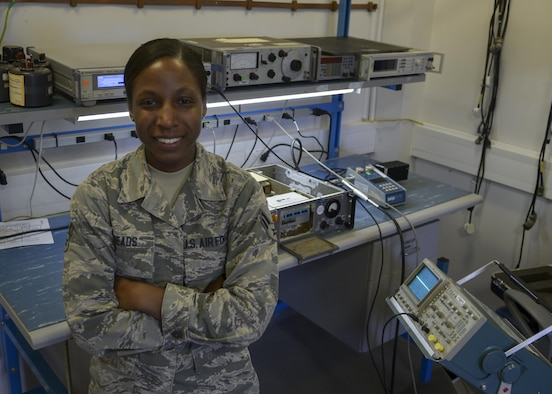 U.S. Air Force Airman 1st Class Shannon Meads, 100th Operations Support Squadron Airfield Systems technician, poses for a photograph in her work center Sept. 22, 2016, on RAF Mildenhall, England. Meads was submitted for the SquareD Spotlight for being an outstanding member of Team Mildenhall. (U.S. Air Force photo by Staff Sgt. Victoria Taylor)