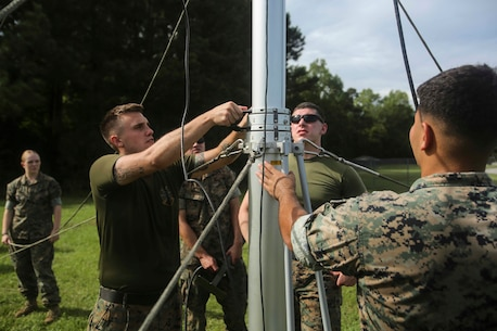 Marines take down a Meteorological Radar Subsystem at Marine Corps Air Station New River, N.C., Sept. 14, 2016. The MRS, being used by Marines with Meteorology and Oceanography platoon, 2nd Intelligence Battalion and Marine Air Traffic Control Detachment Bravo, Marine Air Traffic Control Squadron 2, is used to predict cloud cover, tropical storms and other possible weather systems in the area. (U.S. Marine Corps photo by Lance Cpl. Ashley Lawson/Released)