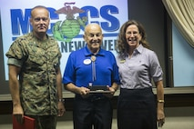 """Mr. Marion """"Cass"""" Carcirieri receives his 40 years of MCCS service award at Marine Corps Base Camp Lejeune, Sept. 21. He is the Camp Geiger MCX manager and served 31 years in the Marine Corps before beginning to work for MCCS Camp Lejeune. (U.S. Marine Corps photo by Cpl. Ned Johnson)"""