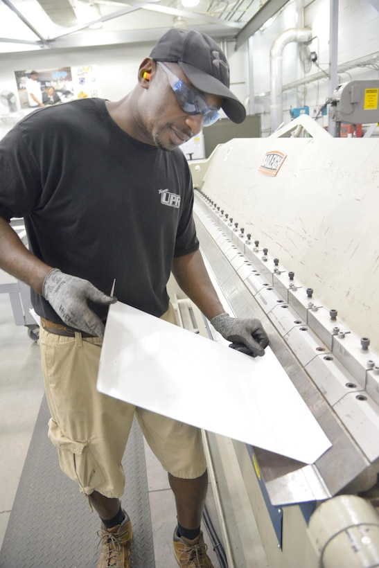 Keith Felder, 402nd Maintenance Support Group sheet metal specialist, performs sheet metal fabrication. The 402nd MXSG is comprised of 400-plus employees at 12 work sites, to include infrastructure engineering, chemical laboratories and the Precision Measurement Equipment Laboratory. (U.S. Air Force photo by Ray Crayton)