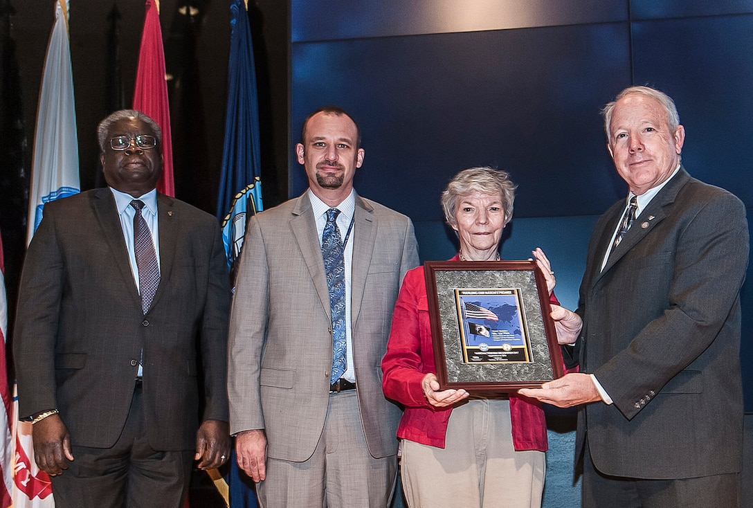 Defense Supply Center Columbus honored National POW/MIA day Sept. 16 inside the Building 20 Auditorium. Pictured are (l-r): Milton Lewis, DLA Land and Maritime acquisition executive; David Glover, DFAS-Columbus; Liz Flick, regional coordinator, The National League of POW/MIA Families; and James McClaugherty, acting commander, DLA Land and Maritime.