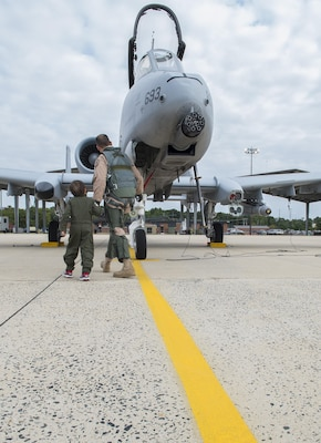 Jack Kirkbride and U.S. Air Force Maj. Steven Montalvo a pilot assigned to the 104th Fighter Squadron, conduct  pre inspection checks prior to aircraft launch at the Warfield Air National Guard in Middle River, Maryland, Sept. 17, 2016. The five year old from Crofton was honored as an A10 Thunderbolt II attack Pilot for a Day.
