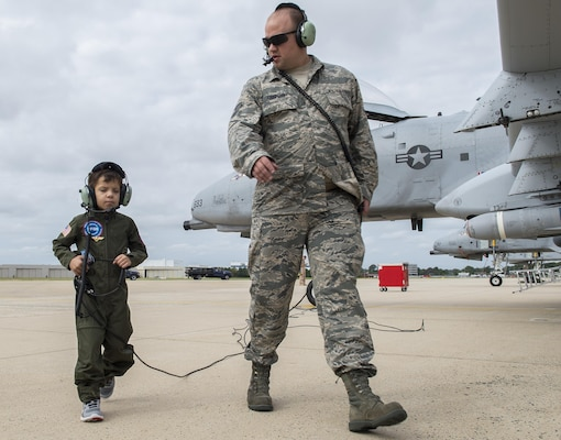 Jack Kirkbride conducts a precheck of the aircraft with an Air Force crew chief assigned to the 104th Fighter Wing, prior to takeoff on the Warfield Air National Guard runway in Middle River, Maryland, Sept. 17, 2016. Jack was given honorary wings and a lifetime membership to the Maryland Air National Guard 175th Fighter Wing.