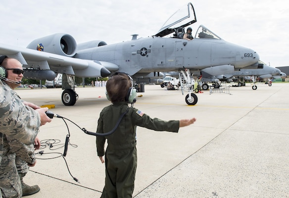 Jack Kirkbride signals U.S. Air Force Maj. Steven Montalvo, an A10 Thunderbolt II pilot assigned to the 104th Fighter Wing, for takeoff on the Warfield Air National Guard runway in Middle River, Maryland, Sept. 17, 2016. Jack was given honorary wings and a lifetime membership to the Maryland Air National Guard 175th Fighter Wing.